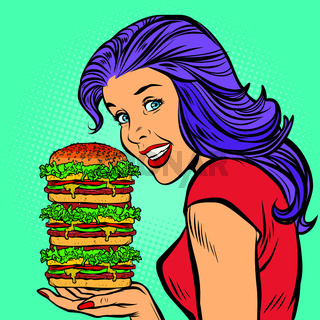 giant Burger. Hungry woman eating fast food