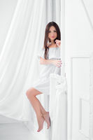 Young nice woman dressed in white dress.