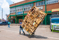 Bogota transport empty wooden boxes Corabastos market