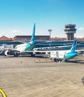 Airplanes at runway, Denpasar airport, Bali