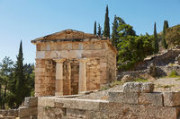 The Athenian treasury in Delphi, Greece in a summer day.