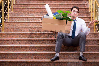 Young businessman on the street after dismissal