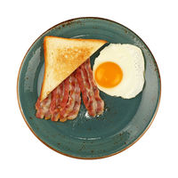 Close up egg, toast and bacon on blue plate