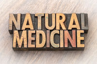 natural medicine text in wood type