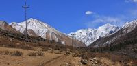 View up the Langtang valley, Nepal. Mountains Tserko Ri and Gangchenpo. Spring scene.