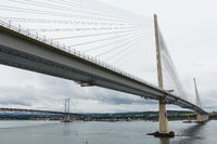 The new Queensferry Crossing bridge over the Firth of Forth with the older Forth Road bridge in Edinburgh Scotland.