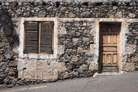 old  house  with wooden door and natural stone facade