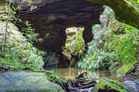 Cave interior with small river and lake