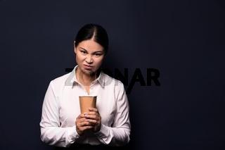 Portrait of businesswoman having coffee