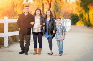 Hispanic Pregnant Family Walking On Path