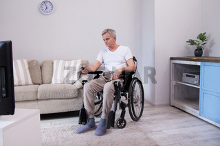 Disabled man watching television.