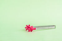 Colorful Silicon, Metal Sugar Tongs on Green Background