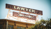 Street Sign to Lawyer