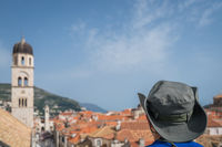 Man with a hat admiring Dubrovnik