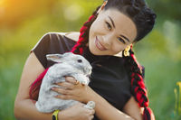 Mature Woman with Red Konekalons Huggs a Rabbit on Nature
