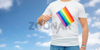 man with rainbow flag and gay pride wristbands
