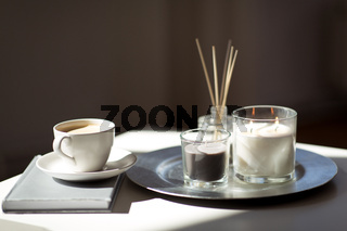 coffee, candles and aroma reed diffuser on table