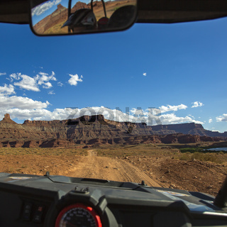 Moab trail and cayon seen from inside a vehicle