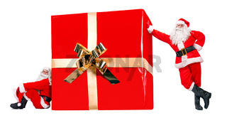 Two Santa Claus with the large Christmas gift box, isolated on a white background. Funny team of Santa offer the big Xmas present.