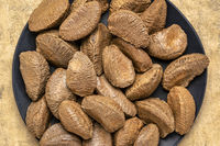 Brazilian nuts on a black plate