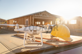 Drone Quadcopter Next to Hard Hat Helmet At Construction Site