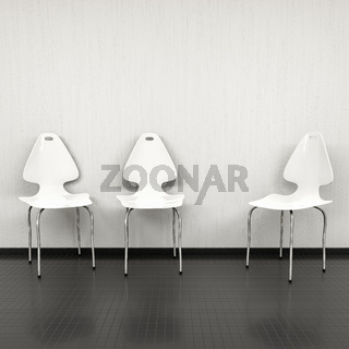 three white chairs at a wall with space for your content