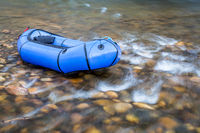 packraft on a rocky river