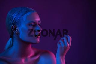 Blue Purple Portrait of Sexy Naked Model in Neon Light on Dark Background