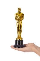Hand with Award of Oscar ceremony