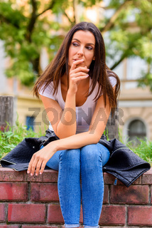 Portrait of a thoughtful woman in a Park