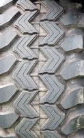 close up of the tread of a heavy duty all terrain vehicle tyre