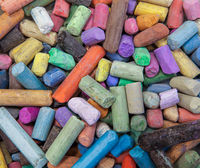 Abstract background of multicolored used crayons. Concept of art and creativity.