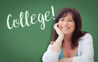 College Written On Green Chalkboard Behind Smiling Middle Aged Woman