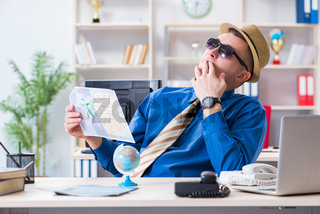 Young employee preparing for vacation trip