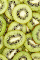 Kiwi fruits collection food background portrait format slices kiwis fresh fruit