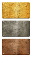 Gold, silver, copper metal plates over white