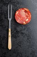 Sliced chorizo salami sausage.