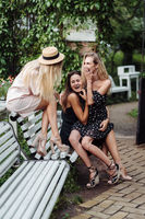 three girls on the bench