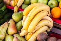 Fresh organic bananas and other fruits