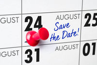 Wall calendar with a red pin - August 24