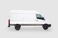 Driving white van isolated on grey background