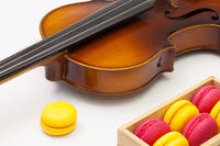 Old violin and traditional french colorful macarons
