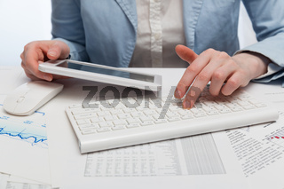 Financial accounting. Business woman using tablet computer