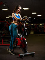Young sporty girl in fitness club