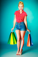 Retro vintage young woman with shopping bags
