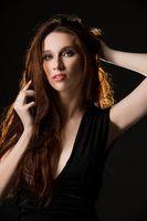Gorgeous brunette in black dress