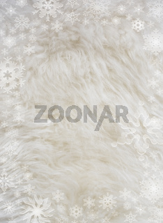 Fluffy white furry sheepskin and snowflakes