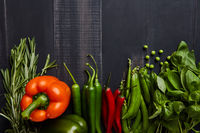 Healthy food background with fresh vegetables and hearbs on wooden table