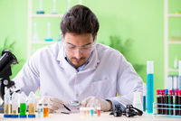 Man chemist working in the lab