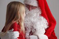 Girl on santa claus knees